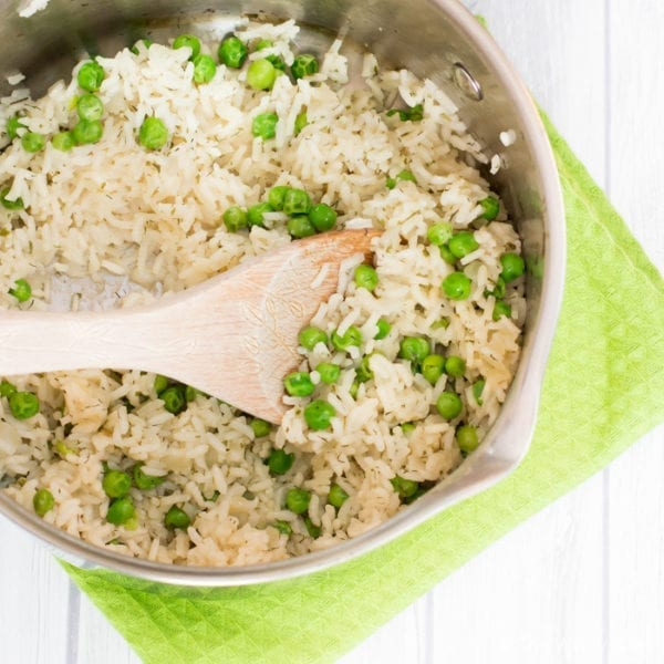 Quick and easy rice pilaf loaded with sweet peas and dill!