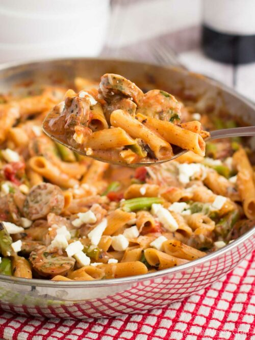 You can't beat this quick pasta skillet recipe loaded with sausage, green beans, tomatoes, and plenty of cheese. Your family will love to eat it, and you'll love to cook it in under 30 minutes!