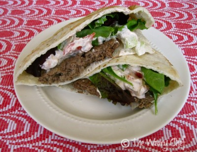 Gyro Burger - Cool, spicy yogurt sauce with cucumber tops a thin beef patty with Greek flavors