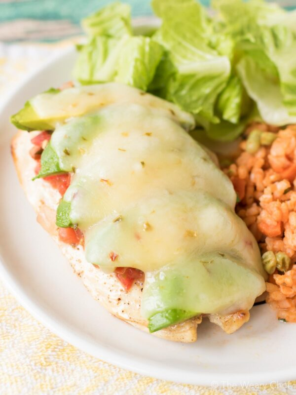 This Cheesy Avocado Salsa Chicken recipe was born for weeknights. You can't beat a delicious chicken dinner that is ready in under 30 minutes!