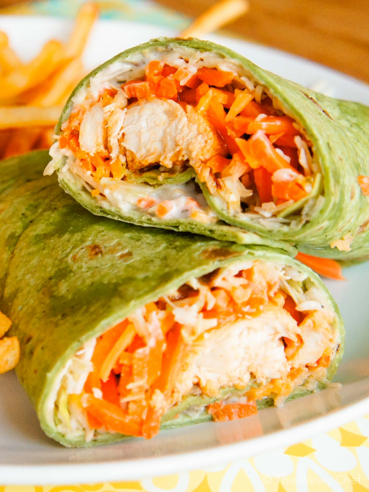 These easy Buffalo Chicken Wraps come together quickly and will please the whole family! & Buffalo Chicken Wraps: A fun and tasty dinner idea! - The Weary Chef