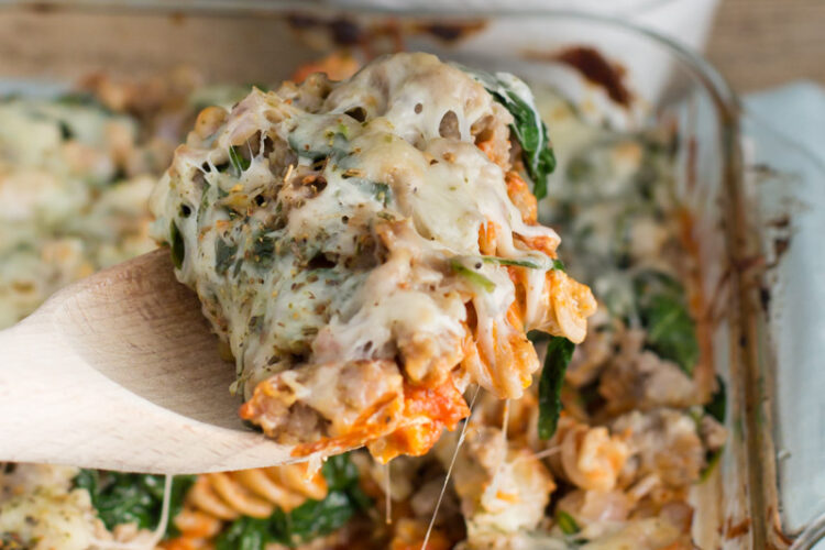 Dig into this delicious Layered Casserole with creamy pasta, savory sausage, tender spinach, and plenty of melted cheese!