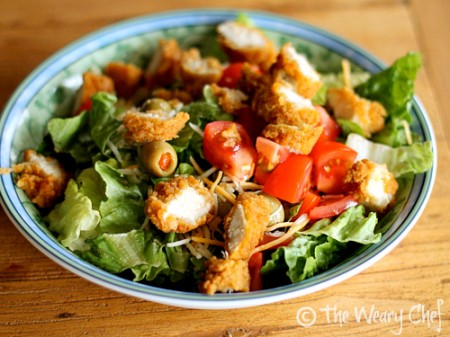 Kid friendly salad with olives, chicken, tomatoes, and cheese | The Weary Chef