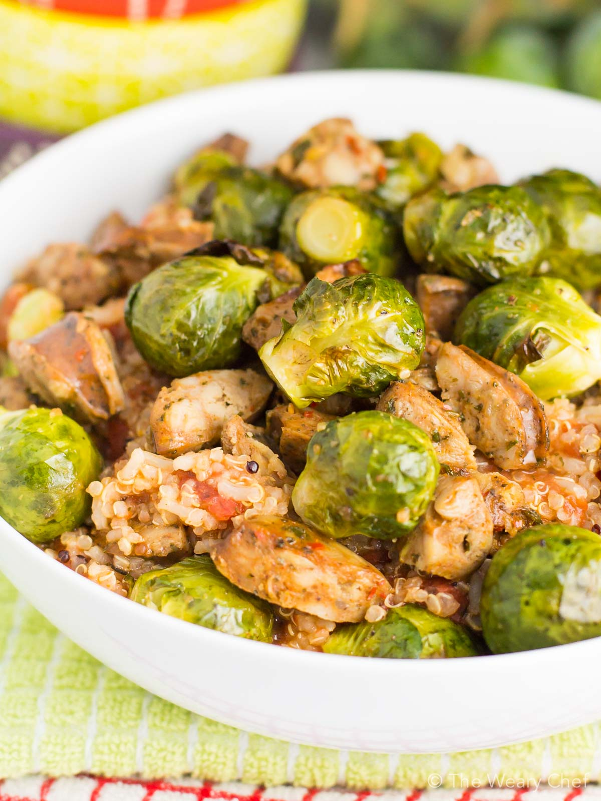 Dig into this fast, delicious, healthy quinoa recipe for dinner! It's loaded with tomatoes, sausage, and brussels sprouts to fill you up in a wholesome way.