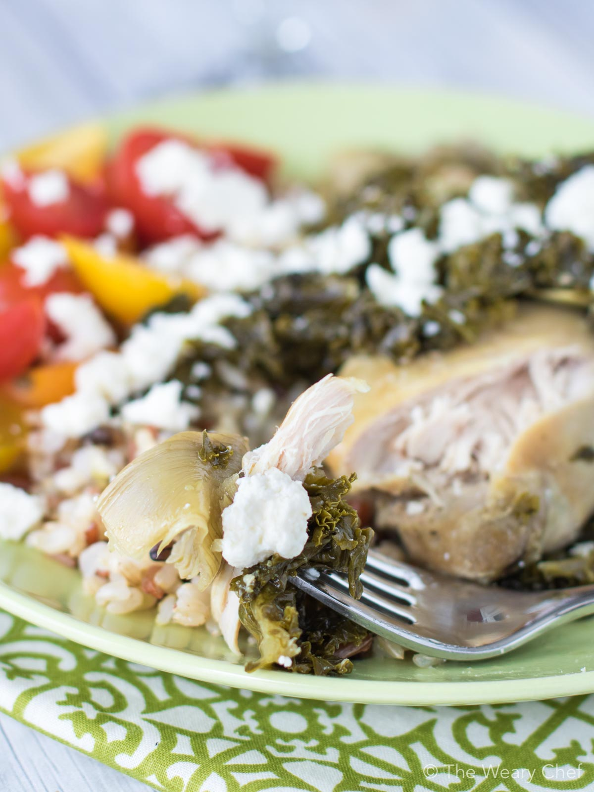 Enjoy these slow cooker chicken thighs simmered with seasoned artichokes, vermouth, and fresh kale.