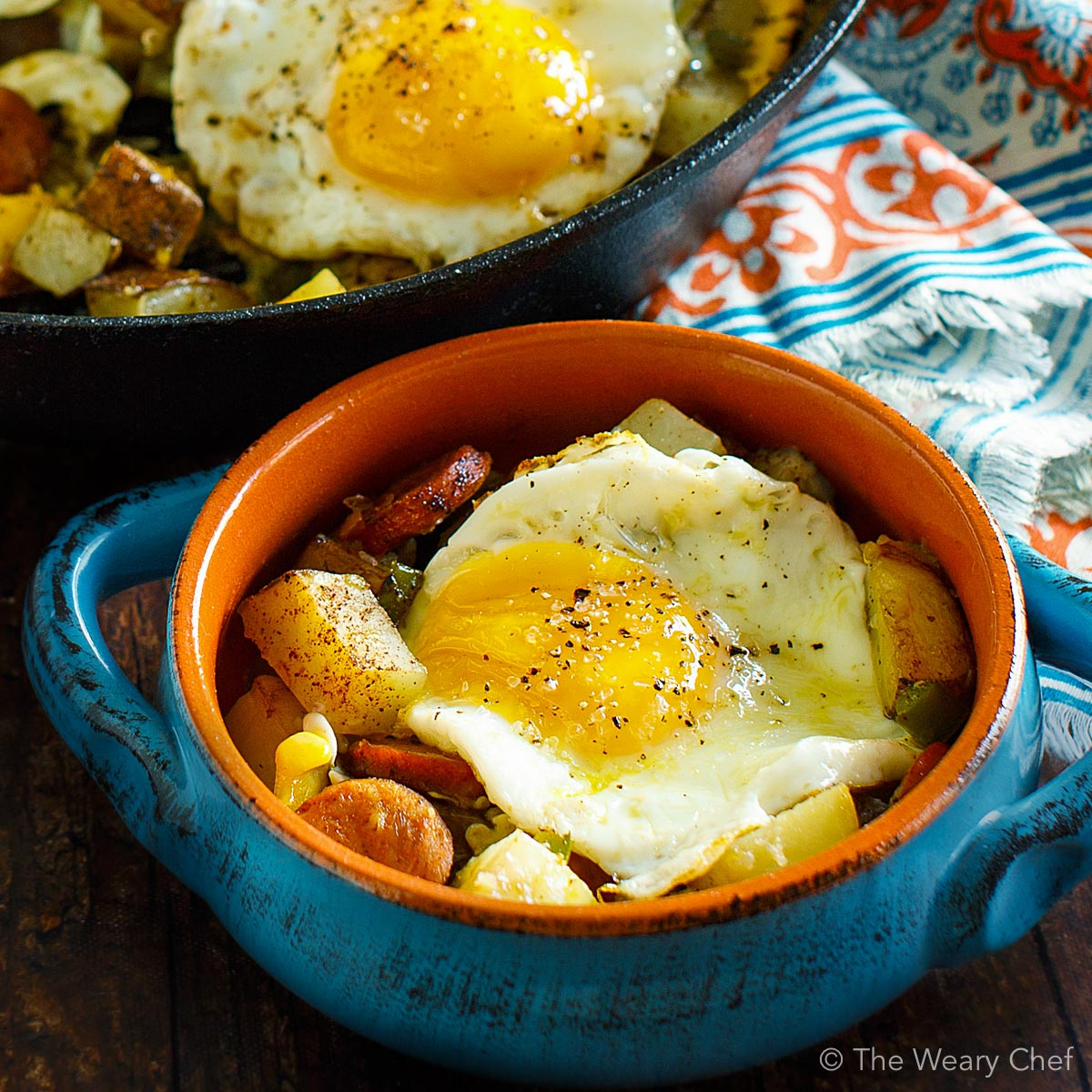 Baked Eggs over Roasted Potatoes and Sausage makes a perfect meal any time of day! #eggs #sausage #potatoes #breakfast