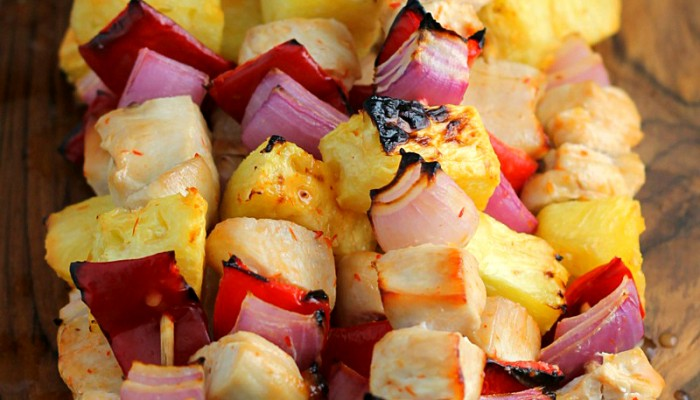 Skewered Pineapple Chicken Recipe - You will love the pop of citrus flavor in these simple chicken kebabs! - wearychef.com