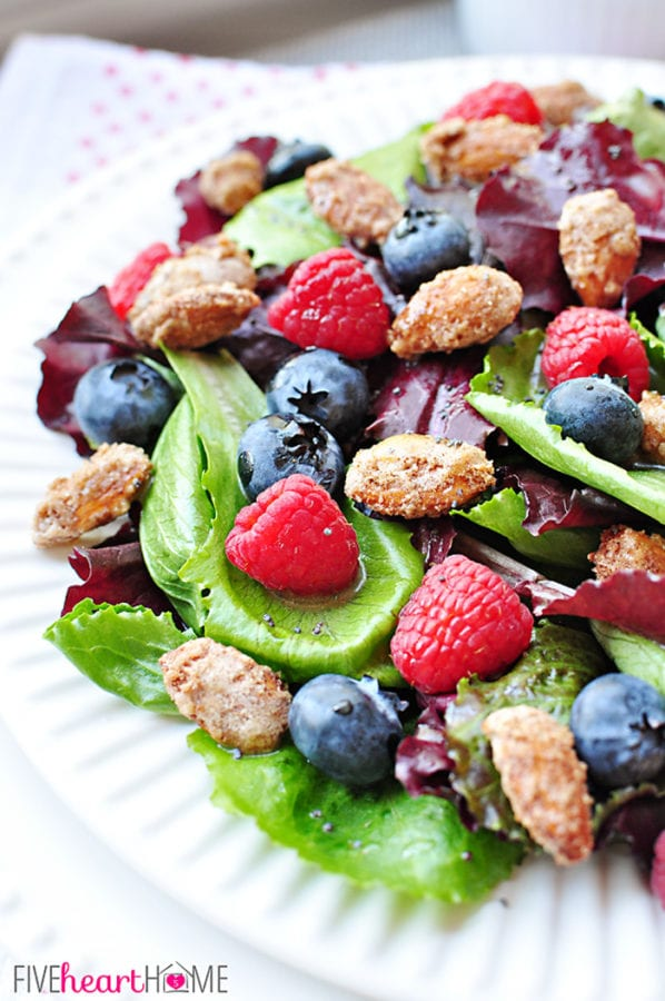 Spring Salad with Mixed Berries, Candied Almonds, and Honey Citrus Vinaigrette by Five Heart Home