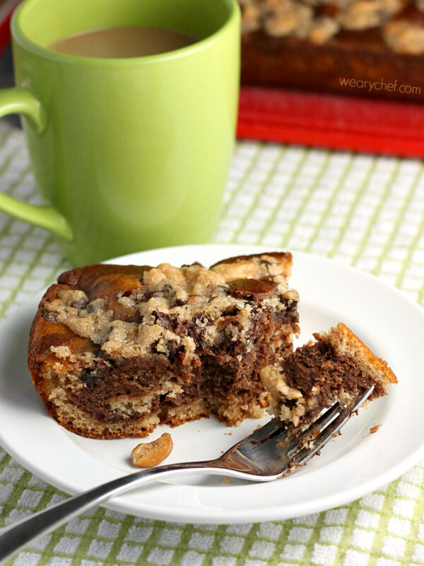 Marbled Chocolate Coffee Cake - Sweetened with applesauce and banana and topped with a chocolate-cashew crumb topping. Perfect for breakfast or dessert!