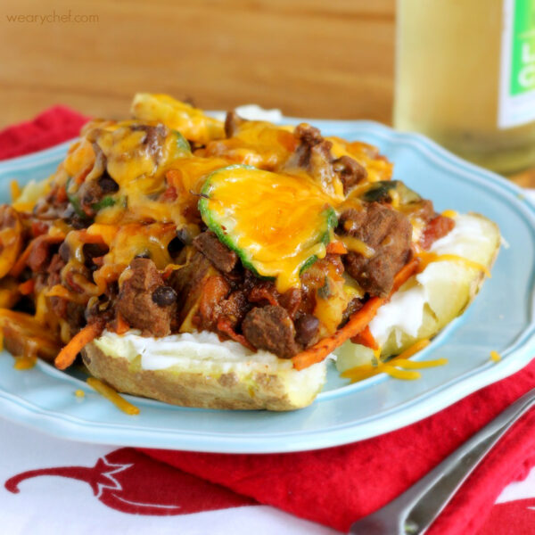 Baked potatoes are mashed with sour cream, smothered in a chunky vegetable beef chili, and topped with a little melted cheddar. This is comfort food at its healthiest! - wearychef.com