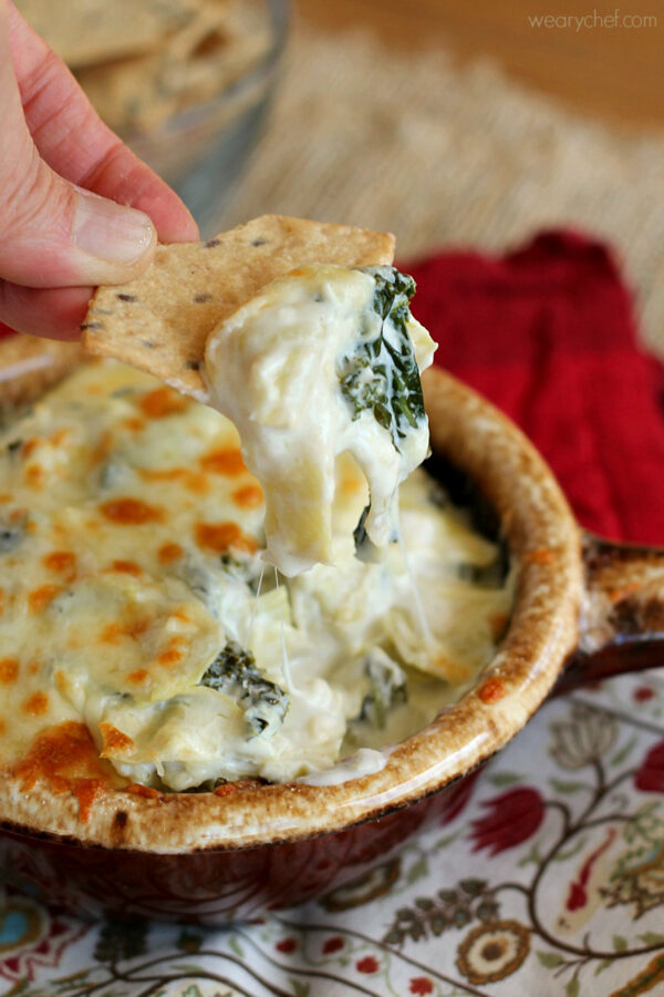 This Kale Artichoke Dip lightened up with reduced-fat ingredients is perfect for entertaining!