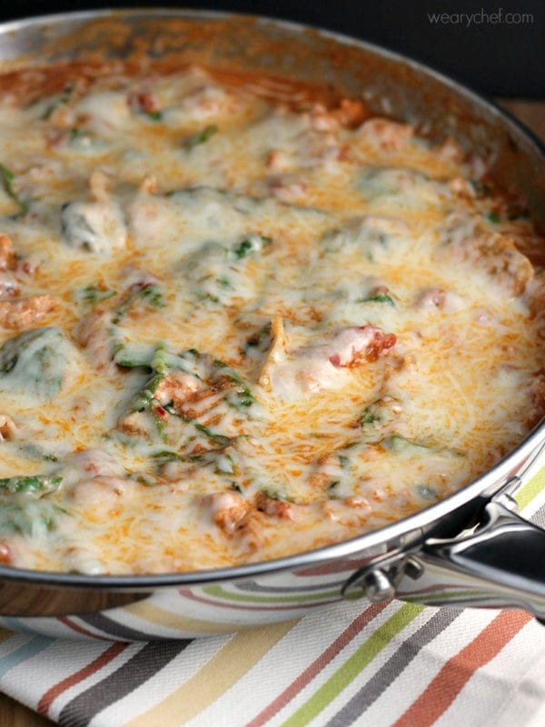 This shortcut lasagna recipe is loaded with tomatoes, ground sausage, spinach, and noodles, all under a blanket of melted cheese. It's ready in under 30 minutes for a great weeknight dinner!