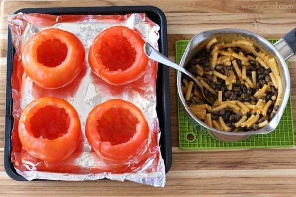 This seemingly fancy dinner is ready in a half hour! You'll love these stuffed tomatoes loaded with Horizon  Organic Mac and Cheese with Black Beans!