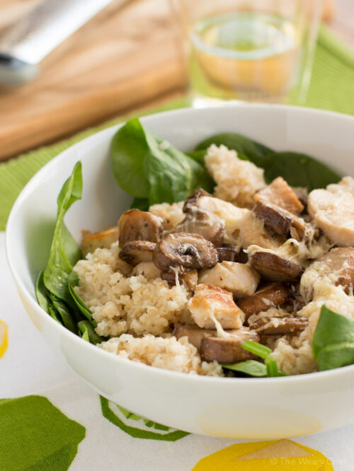 This warm spinach salad with chicken, mushroom, couscous, and a lemon dressing is delicious, healthy, and quick!