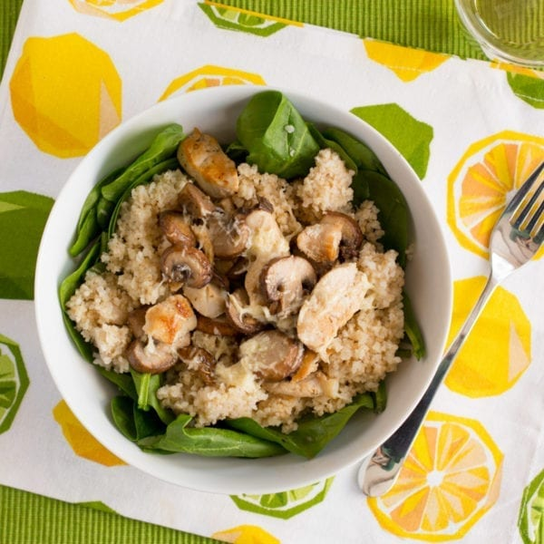 This warm spinach salad with chicken, mushrooms, couscous, and a lemon dressing is delicious, healthy, and quick!