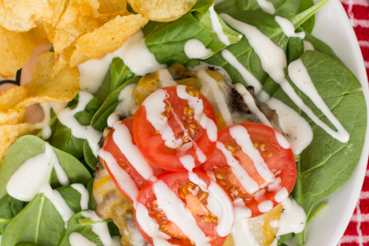 Try a juicy beef patty on a bed of baby spinach topped with melted cheese, sliced tomatoes, and Ranch dressing. Cheeseburger Ranch Salad may be your new favorite way to eat a burger!