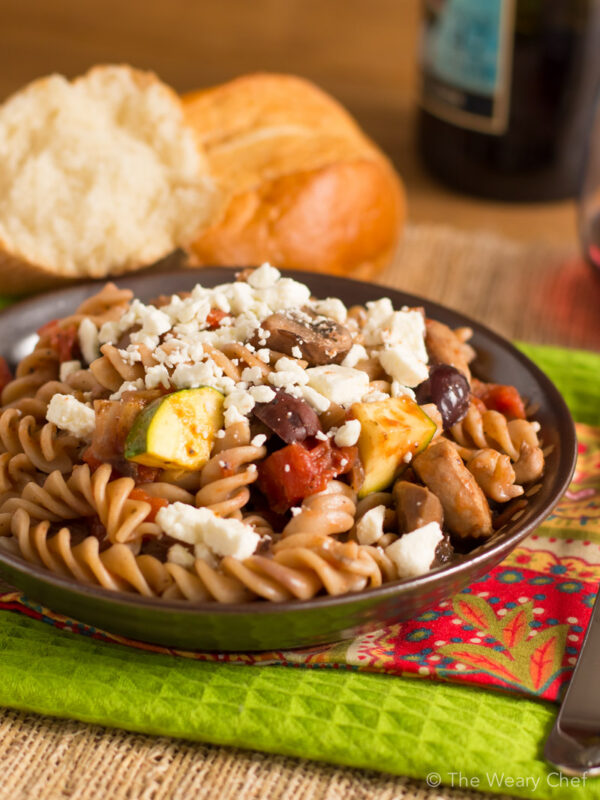 You'll love this easy pasta dinner recipe loaded with chicken, vegetables, olives, and topped with feta!