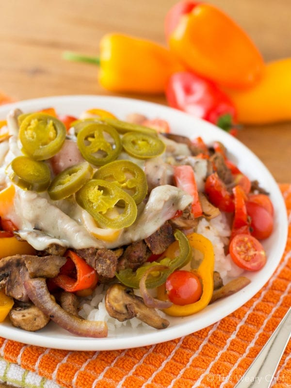Enjoy a classic sandwich in a new way with these tasty cheesesteak rice bowls!