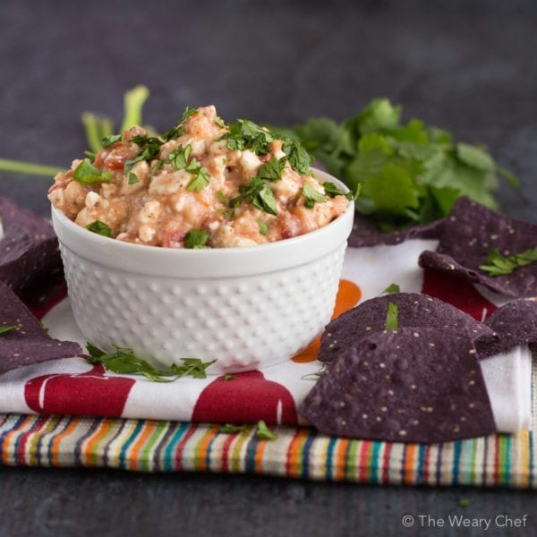 Four ingredients and five minutes is all you need for this tasty Shrimp Taco Dip!