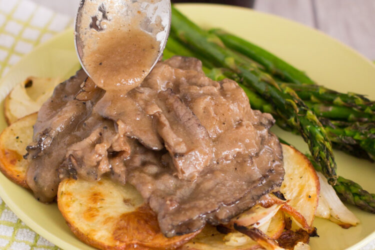 This easy recipe for roast beef and gravy served over potatoes and onions is perfect for Sunday dinner or busy weeknights!