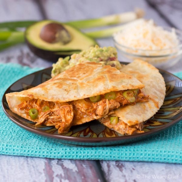 Need a quick dinner idea? Look no further than these easy quesadillas stuffed with enchilada chicken!
