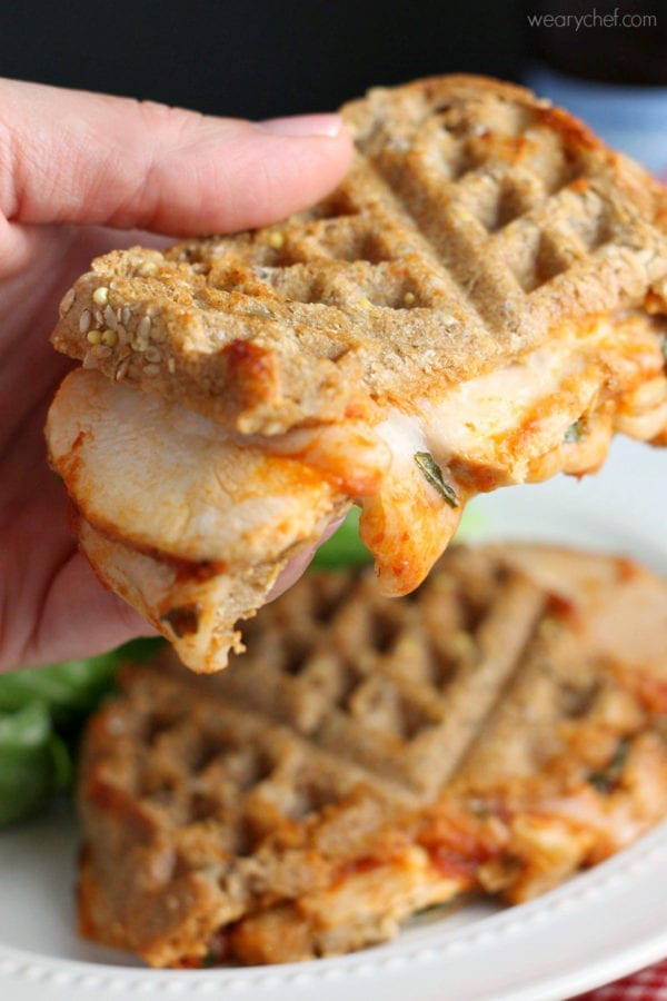 This caprese grilled cheese sandwich is loaded with melted mozzarella, chicken, and marina sauce. An easy comfort food dinner recipe!
