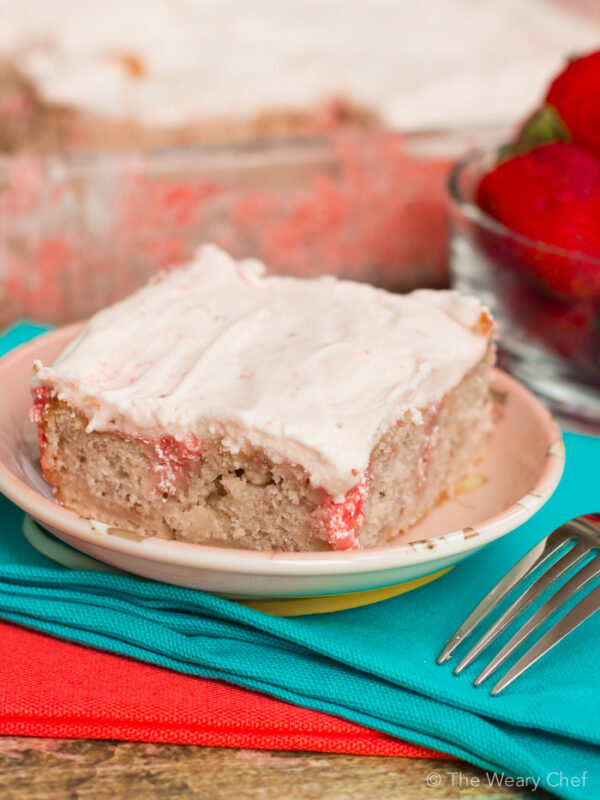 This easy strawberry poke cake is made with all natural mixes and fresh berries!