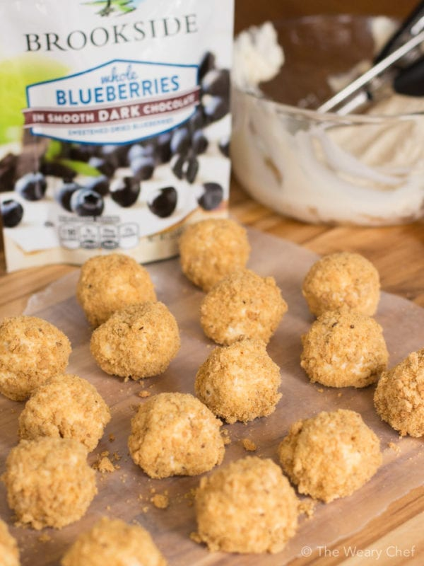 These no-bake cheesecake bites stuffed with dark chocolate blueberries are fun to make and so satisfying!