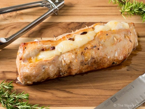 This mesquite flavored pork loin is stuffed with sun-dried tomatoes and provolone for an easy but impressive entree!