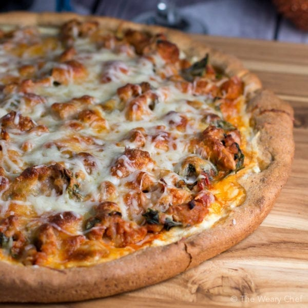 Lasagna pizza has a layer of ricotta topped with meat sauce and cheese. It's a hearty pizza recipe you'll love!