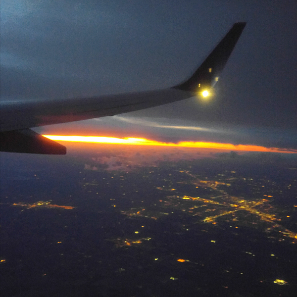 Watching the sunrise from the plane.