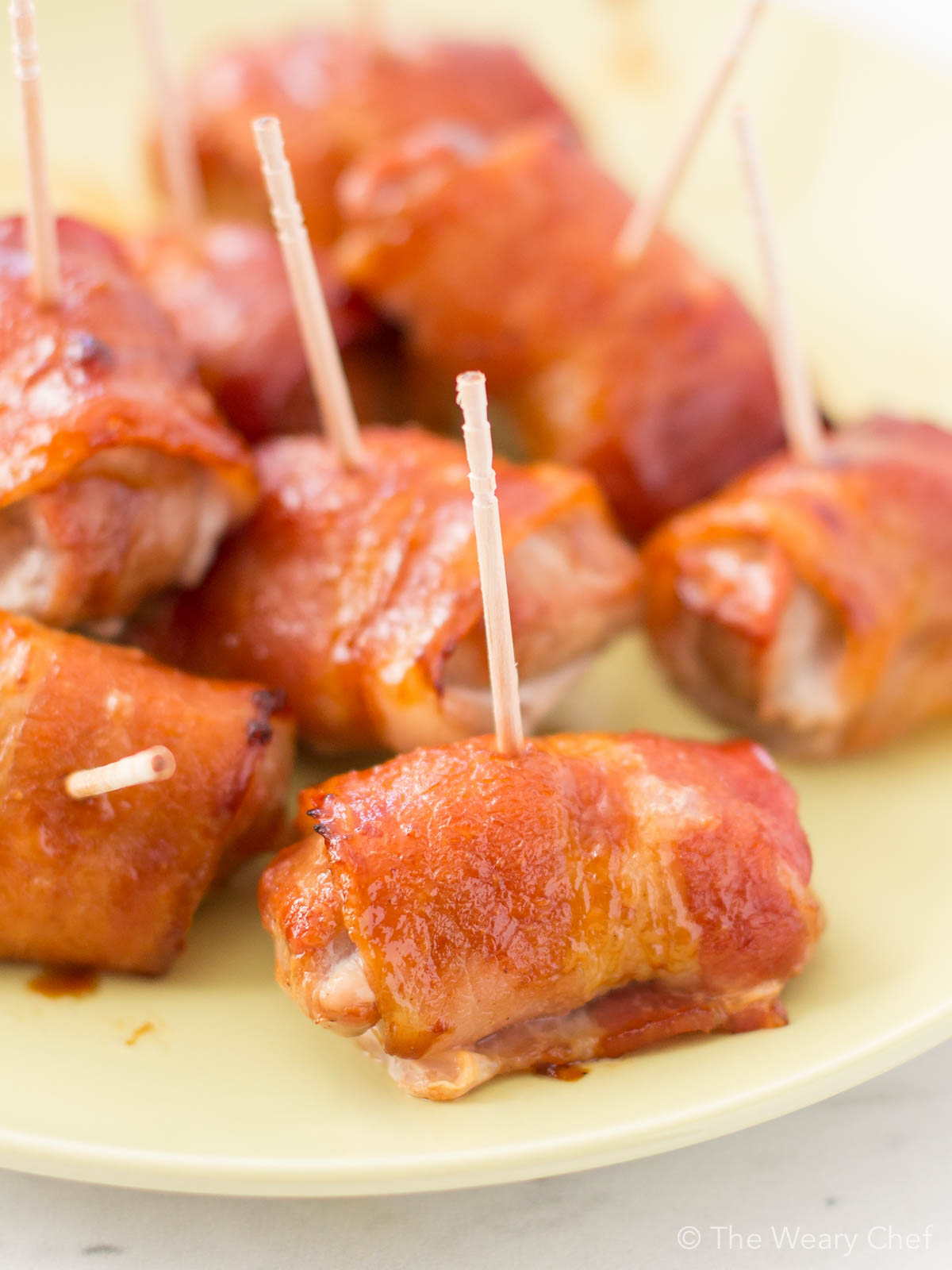These super easy bacon-wrapped pork bites with teriyaki sauce will be the stars of any party!