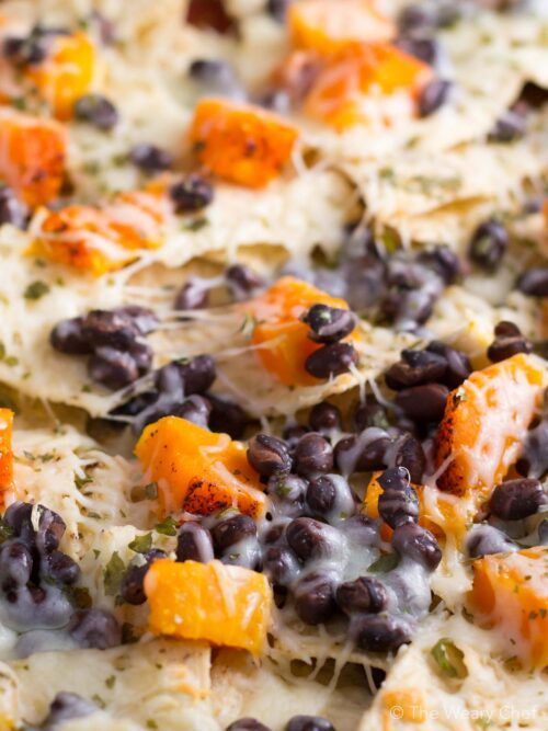 Add Fall flavor and a healthy vegetable to nacho night with these Butternut Squash and Black Bean Nachos!