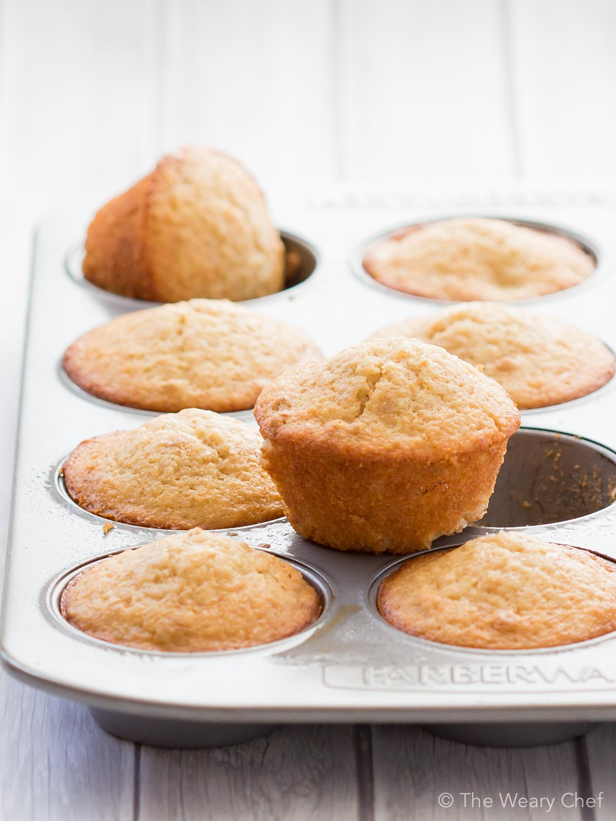 Banana, coconut, and pineapple muffins are made easy and delicious with Greek yogurt and baking mix!