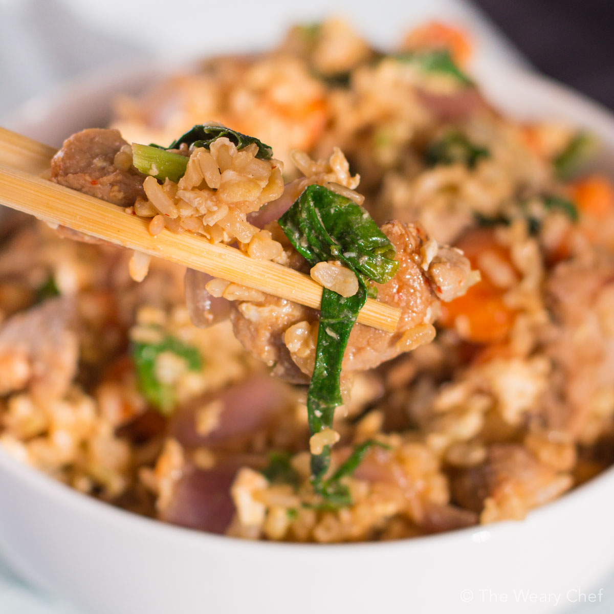 This quick and flavorful pork fried rice can be made in under 20 minutes and is a versatile dinner recipe that uses what you have on hand!