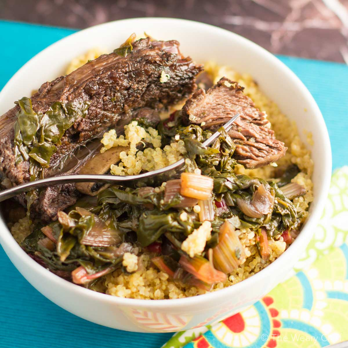 Stewing beef short ribs with chard over low heat makes for a succulent, easy dinner!