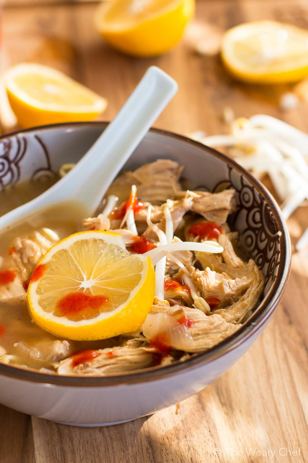This flavorful, healthy ginger chicken soup with lemon is perfect for nursing a cold!