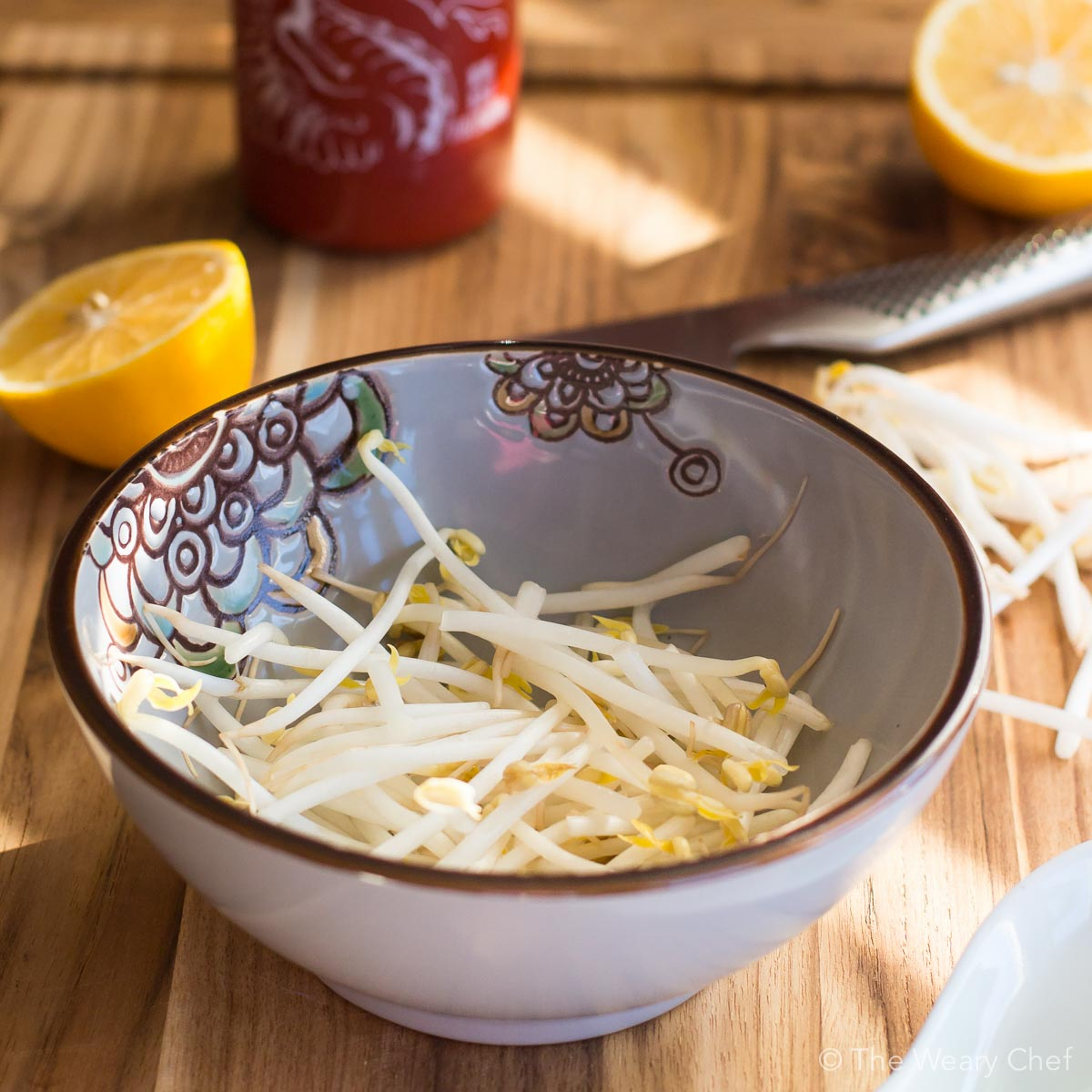 Serving soup over bean sprouts is a tasty and healthy alternative to noodles.