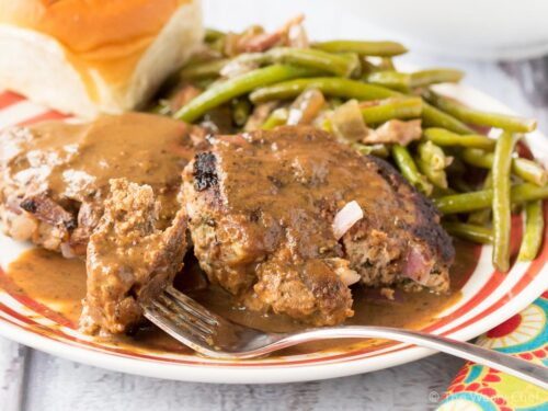 These onion burger steaks smothered in an easy brown gravy are just the ticket for a simple, comforting dinner recipe!