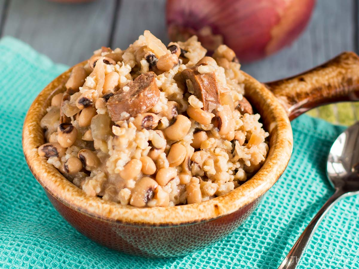 This classic black eyed pea recipe is made easy with your crockpot. You'll love Slow Cooker Hoppin John for a quick and easy Southern dinner.