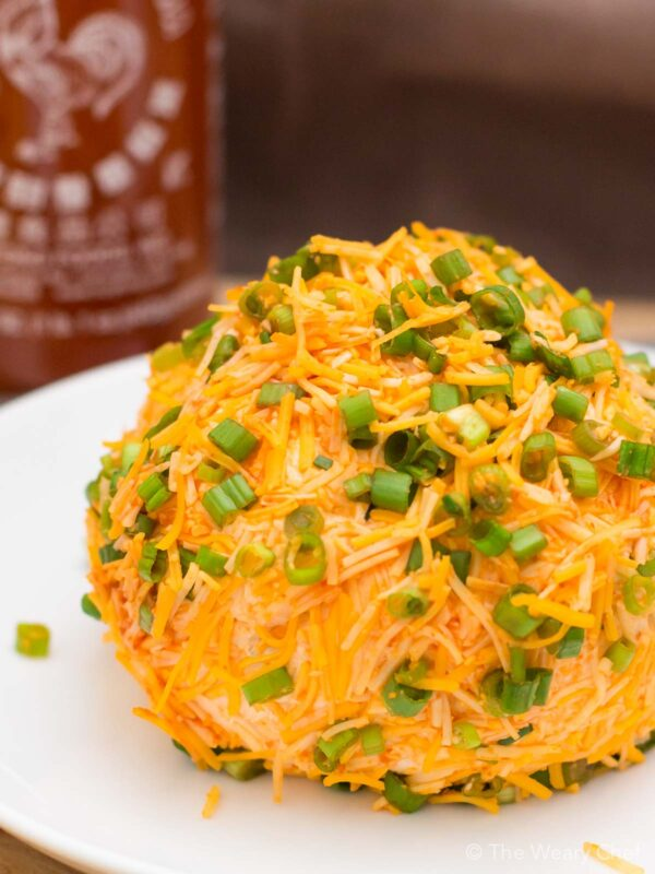 No party is complete without a cheese ball. Spice up your next gathering with this super simple Sriracha Cheddar Cheese Ball recipe. Your friends will thank you!