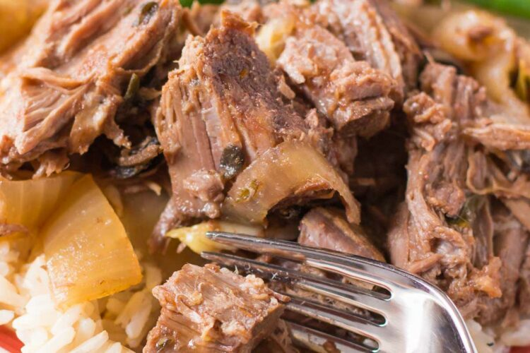This pot roast is LOADED with garlic and onion flavor. It's so easy to make right in your slow cooker!