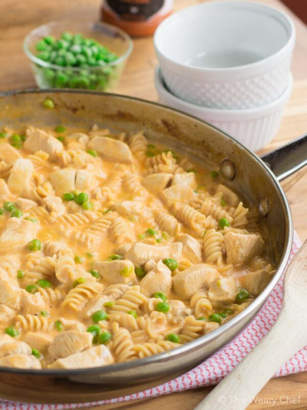 Check out this spicy, tangy, creamy Buffalo Chicken Pasta recipe! It all comes together in one pan in under 30 minutes. You'll love this easy dinner!
