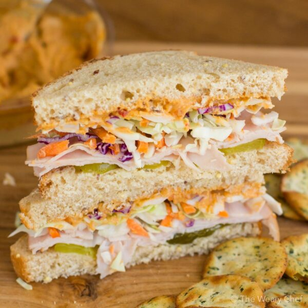 You'll love this easy sandwich for lunch. It features turkey, hummus, pickles, and cabbage for lots of flavor and crunch!