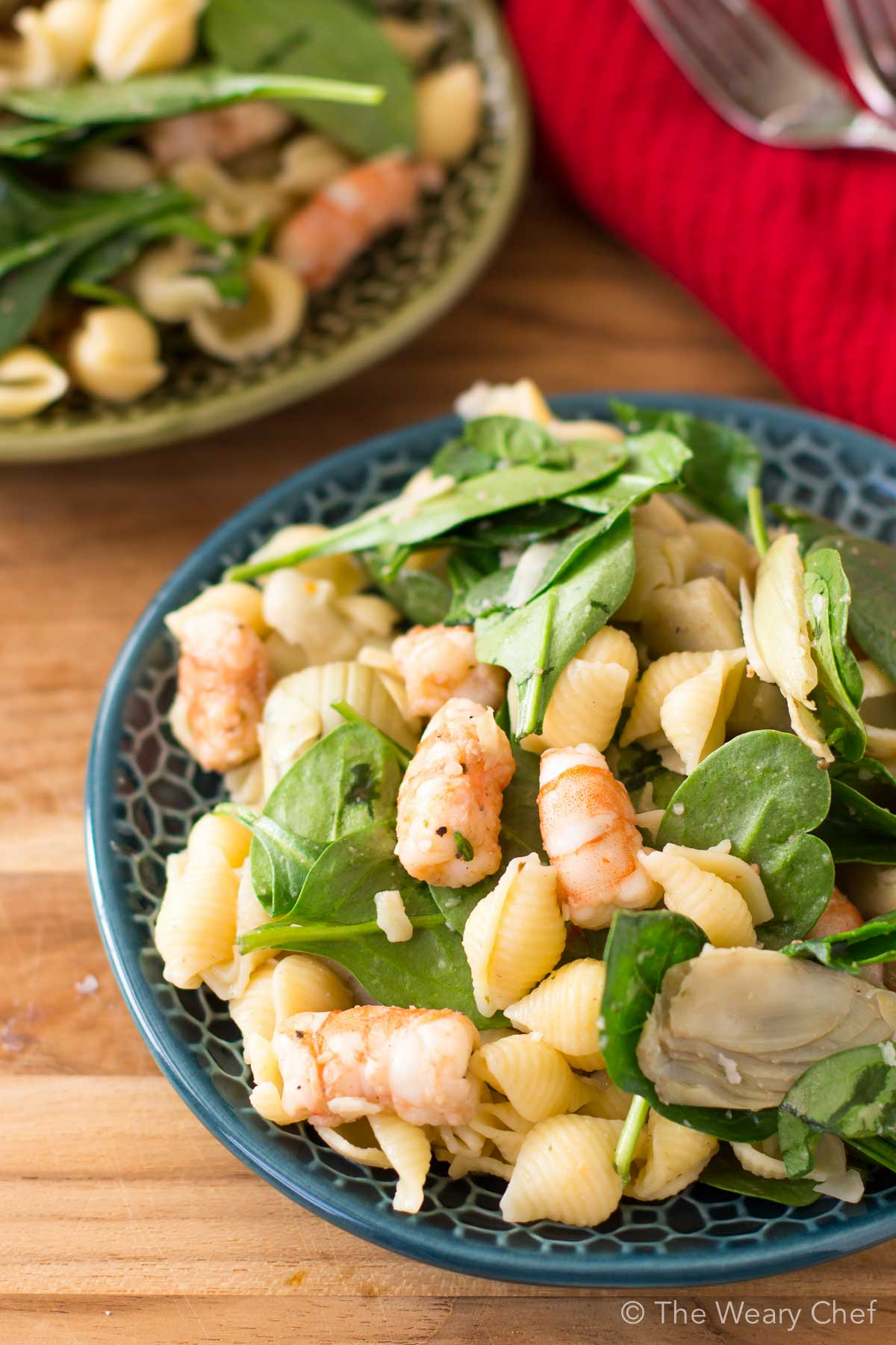 This shrimp pasta salad with spinach and artichokes is a perfect warm weather dinner or potluck dish! It's quick to make and can be served cold or slightly warm.