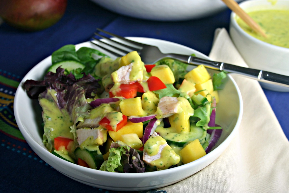 Enjoy this fresh chopped salad with mango vinaigrette for dinner tonight!