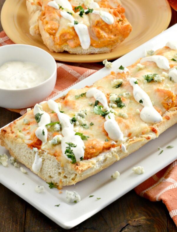 This delicious Buffalo Chicken French Bread Pizza recipe is ready in just about 20 minutes! It's a perfect party appetizer or quick dinner!
