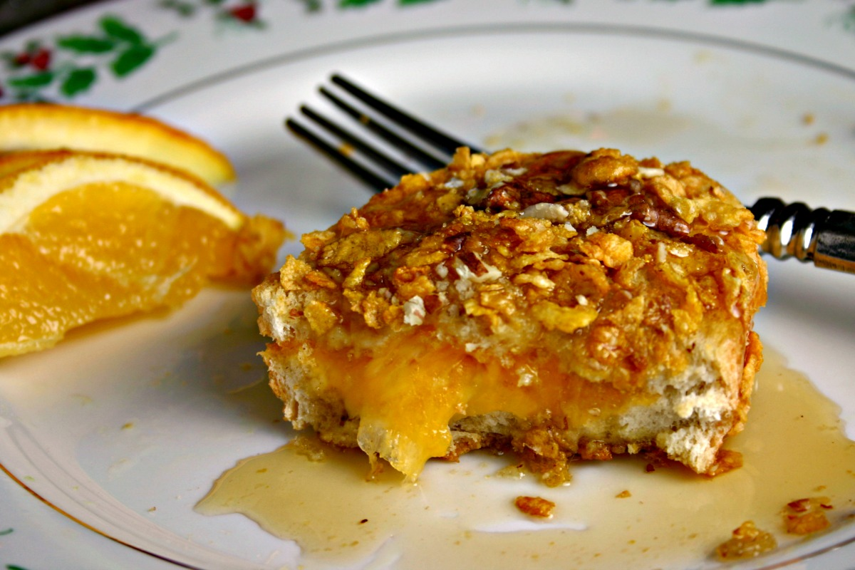 Cheese-stuffed french bread is dredged in egg and coated with cornflakes and pecans for a savory french toast to remember!