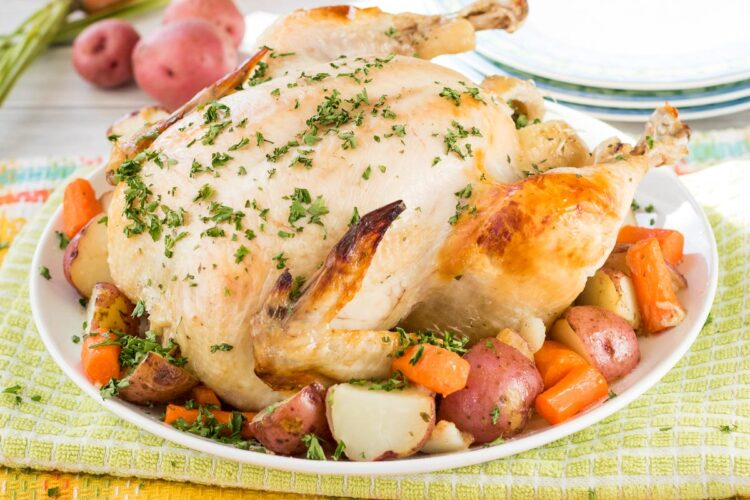 This perfectly juicy dutch oven roast chicken is seasoned with Ranch flavor and turns out perfectly every time!