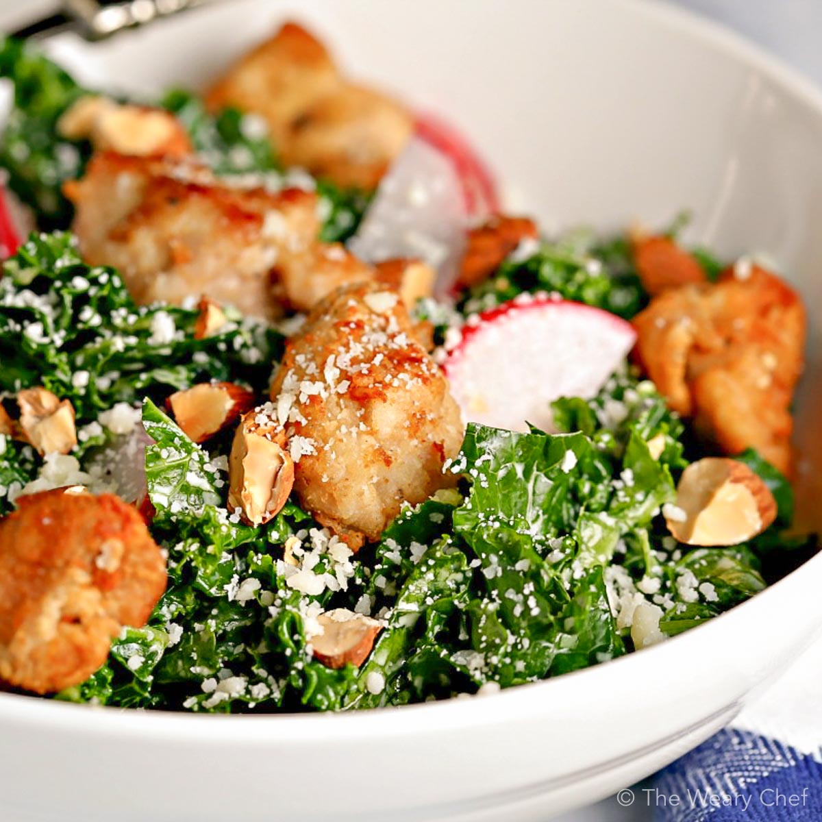 Chicken Caesar Salad with kale is lightened up with a reduced-fat caesar dressing. Great weeknight dinner!